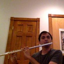 Sre playing the flute