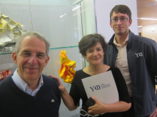 Michel Devoret, Martha W Lewis and Florian Carle in front of YQI display case