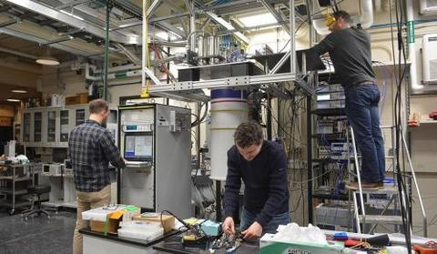 Researchers working on the dilution fridge