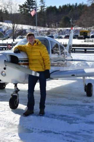 Chris Axline by his plane